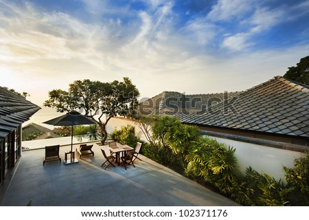 Sunrise at twilight in villa resort - stock photo