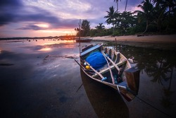 Sunrise background and boat as object at Bintan Island