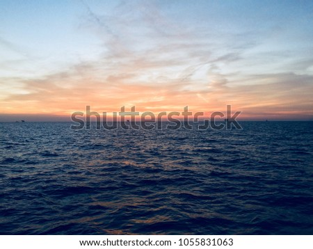 sunrise beautiful view at ocean , fresh morning image, blue ocean water golden clouds and sky, golden sunrise and sunset view HD image #1055831063