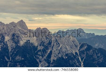 Sunrise behind a mountain ridge. - Shutterstock ID 746558080