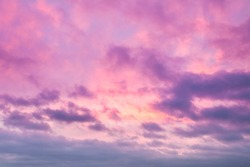 Sunrise clouds skyscape soft pink and purple tones. Majestic summer day cloudy weather. Romantic atmosphere of trendy background illustration desigh in warm pattern. Lovely rose sky panorama shot