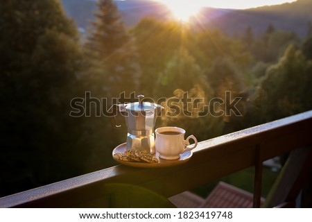 Sunrise coffee. Breakfast with coffee in nature. Dawn in the forest with coffee. Beautiful sunrise. Morning cup of hot drink with mountain background at sunrise. World coffee day. Sunrise tea