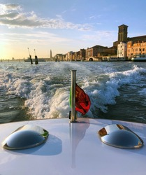 Sunrise departure from iconic Venice, Italy, via private water taxi