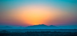 Sunrise frame and the layers of mountain from Arabian desert of Saudi Arabia.