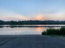 Sunrise from a boat ramp at Oak Ridge Marina, Oak Ridge, Tennessee with reflections in Melton Lake