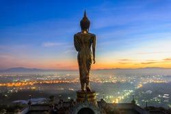 Sunrise, Golden buddha statue in Khao Noi temple, Nan Province, Thailand