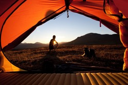 Sunrise, hiker and tent