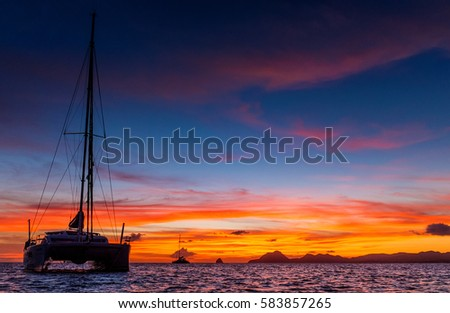 Sunrise in Caribic with catamaran in front of view #583857265