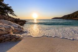 Sunrise in Marble beach (Saliara beach), Thassos Island, Greece. The most beautiful white beach in Greece