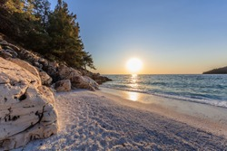 sunrise in Marble beach (Saliara beach), Thassos Island, Greece. The most beautiful white beach in Greece