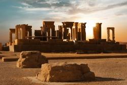 Sunrise in Persepolis, capital of the ancient Achaemenid kingdom. Ancient columns. Sight of Iran. Ancient Persia. Sunrise background.
