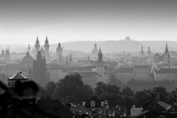 Sunrise in Prague, monochromatic black and white panorama with many church towers and Vitkov hill in background