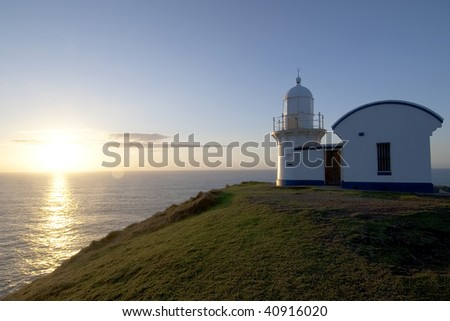 Sunrise in Tacking Point Lighthouse - stock photo