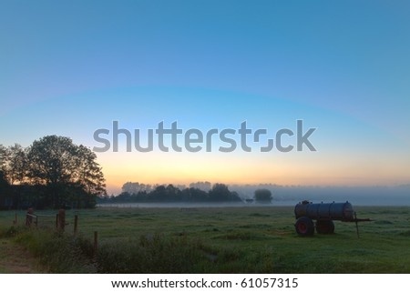 Sunrise in the countryside with morning mist