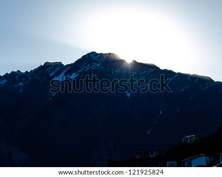 Sunrise in the Himalayas, the first rays of the sun -  view from Auli, India.