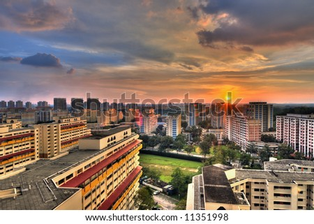 Sunrise in the neighborhood of Singapore where the cityscape is dominated with high rise buildings