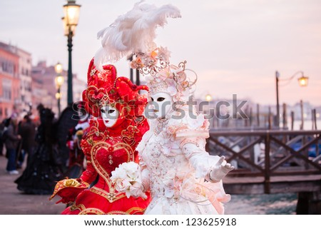 Sunrise in Venice Italy in front of the Grand Canal  Beautiful costumed woman