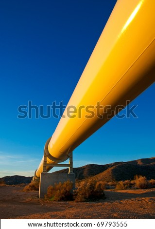 Sunrise light on a pipeline in the Mojave Desert, California.