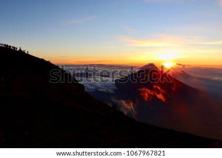 Sunrise Morning Dawn View from the Summit of Acatenango Volcano on Adventure Travel Hiking Trip #1067967821