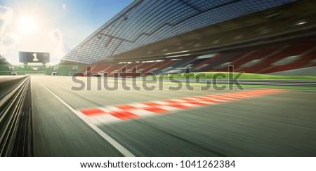 Sunrise motion blur effect asphalt international race track with #1041262384