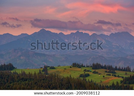 Sunrise, mountain meadows and wild forests. View of the High Tatras from Gliczarow Górny in summer. Poland  Zdjęcia stock ©