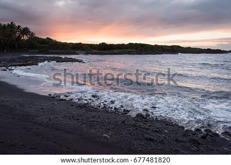 Sunrise on a black-sand beach #677481820