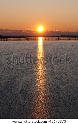 sunrise on a forest lake with clouds