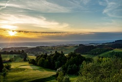 Sunrise on a golfcourse in the alps