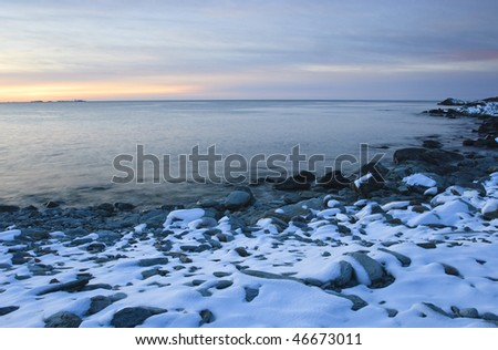 Sunrise on a snowy New England beach
