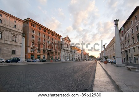 Sunrise on a street without people in the city of Rome, Italy