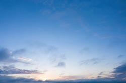 sunrise on blue sky. Blue sky with some clouds.