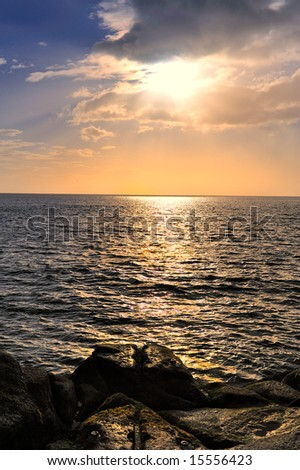 sunrise on dublin bay with rocks in foreground ez canvas