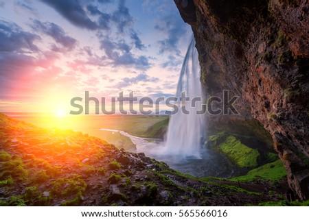 Sunrise on Seljalandfoss waterfall on Seljalandsa river, Iceland, Europe.