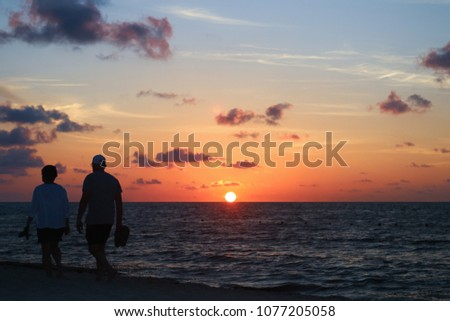 Sunrise on the Caribbean sea beach.
