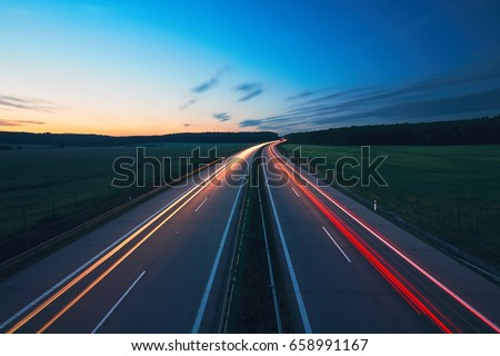Sunrise on the highway in the middle of the countryside. Transportation and cars theme.
