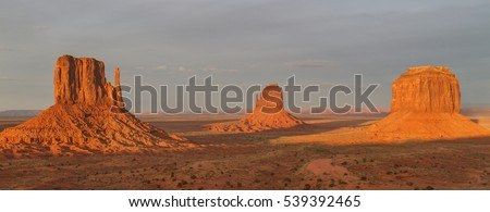 Sunrise on the Mittens - The sun rises and shines on the most famous and iconic monuments in Monument Valley - the West Mitten and the East Mitten. Also know as the Left Mitten and the Right Mitten. #539392465