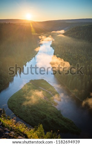 Stock Photo Sunrise on the North of the Ural river. Usva river, Perm region, Russia. Usvinskie poles.