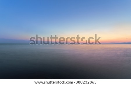 sunrise on the water / Early summer morning bright sky Beach #380232865