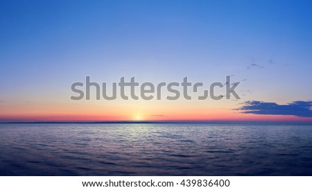sunrise on the water / Early summer morning bright sky Beach #439836400