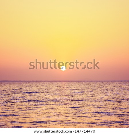 Sunrise or sunset over the sea with retro filter effect, summer concept