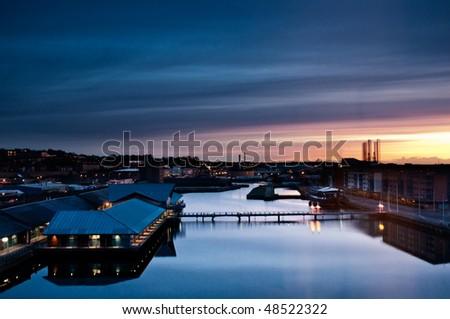 Sunrise over a city port