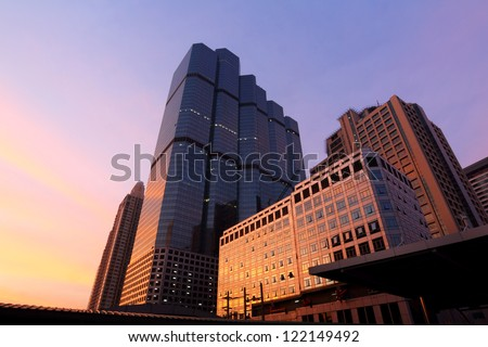 Sunrise over business area , buildings in the city of bangkok