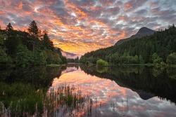 Sunrise over Glencoe Pap mountain and the Lochan, Highlands, Scotland.