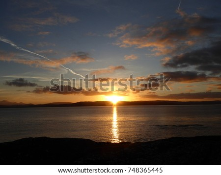 Sunrise over Grasspoint on the Isle of Mull , Scotland . The sun coming up over the sea