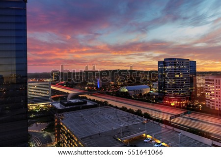 Shutterstock Sunrise over light trails and city lights on a highway in Irvine, California, USA.