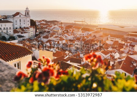 Sunrise Over Lisbon Old Town Alfama - Portugal. Lisbon Golden Hour Skyline. Sun Rising Over Tagus River. Balcony View on Old Town of Lisbon #1313972987