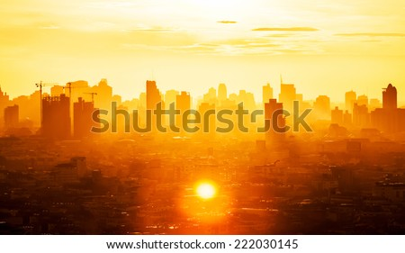 Sunrise over modern office buildings in business district center of Bangkok. Skyline view of cityscape with sunlight and flare in warm light color tone. Construction business concept. #222030145