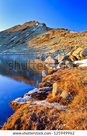 sunrise over part of mountain lake