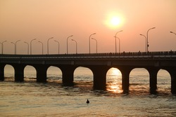 Sunrise over Sina-Male' bridge in Male', Maldives