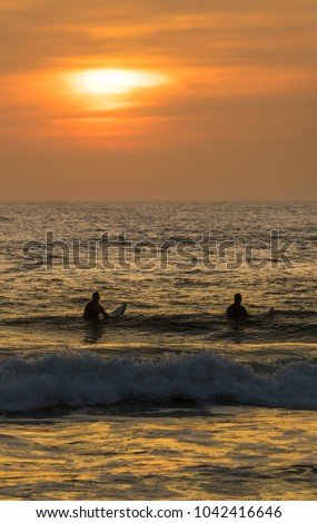 Sunrise Over The Atlantic Ocean At St Augustine Beach In Florida Two Surfer Wait For
